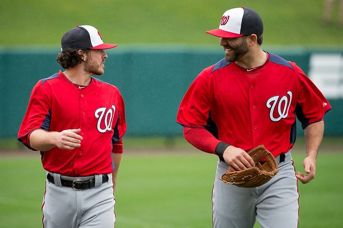 Washington Nationals second baseman Will Rhymes (17) and Washington Nationals second baseman Danny Espinosa (8) walk to the dugout after warm ups before the Washington Nationals play the Atlanta Braves during spring training at Champion Stadium, Kissimmee, Fla., Tuesday, February 26, 2013. (Andrew Harnik/The Washington Times)