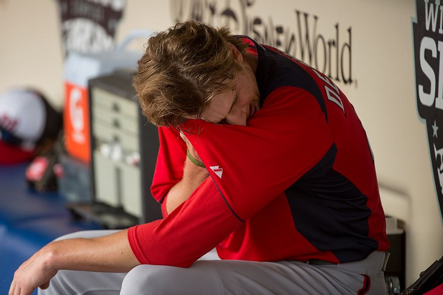 Washington Nationals starting pitcher Ross Detwiler (48) sits in the dugout after pitching as the Washington Nationals play the Atlanta Braves during spring training at Champion Stadium, Kissimmee, Fla., Tuesday, February 26, 2013. (Andrew Harnik/The Washington Times)