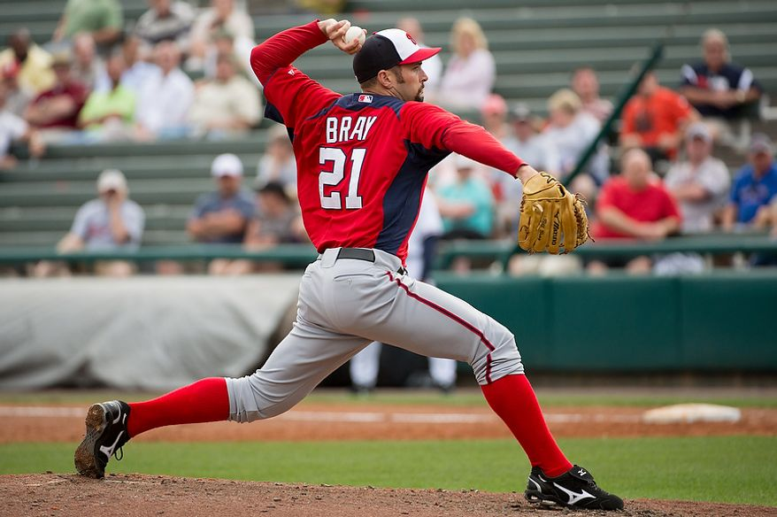 Washington Nationals relief pitcher Bill Bray (21) pitches as the Washington Nationals play the Atlanta Braves during spring training at Champion Stadium, Kissimmee, Fla., Tuesday, February 26, 2013. (Andrew Harnik/The Washington Times)