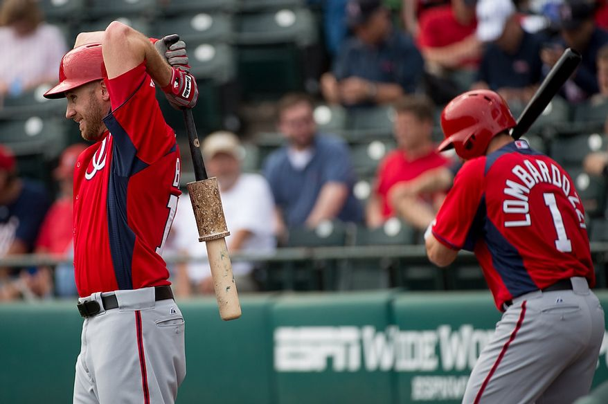Washington Nationals left fielder Corey Brown (10), left, and Washington Nationals second baseman Stephen Lombardozzi (1), right, get ready to bat as the Washington Nationals play the Atlanta Braves during spring training at Champion Stadium, Kissimmee, Fla., Tuesday, February 26, 2013. (Andrew Harnik/The Washington Times)