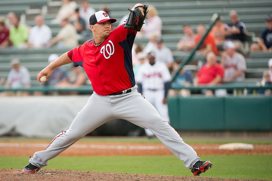 Washington Nationals relief pitcher Cole Kimball (65) pitches as the Washington Nationals play the Atlanta Braves during spring training at Champion Stadium, Kissimmee, Fla., Tuesday, February 26, 2013. (Andrew Harnik/The Washington Times)