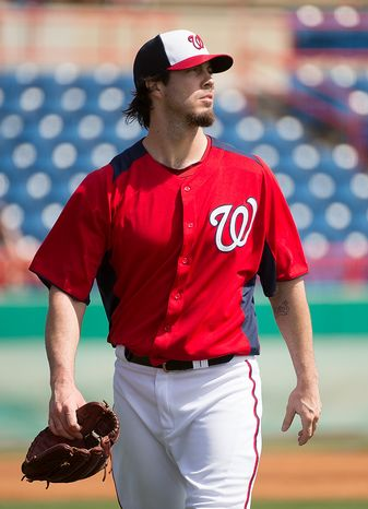 Washington Nationals starting pitcher Dan Haren (15) walks to the dugout as the Washington Nationals play the Florida Marlins during spring training at Space Coast Stadium, Viera, Fla., Wednesday, February 27, 2013. (Andrew Harnik/The Washington Times)
