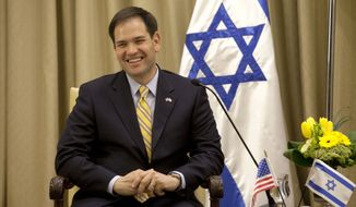 **FILE** Sen. Marco Rubio, Florida Republican, speaks during a meeting with Israel's President Shimon Peres in the President's residence in Jerusalem on Feb. 20, 2013. (Associated Press)
