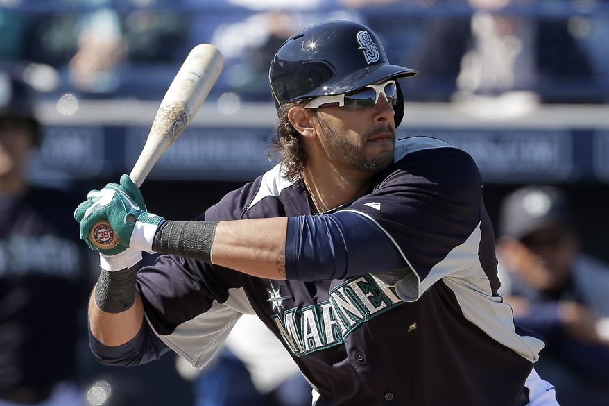 Seattle Mariners' Michael Morse bats during an exhibition baseball game against the San Diego Padres Friday, Feb. 22, 2013, in Peoria, Ariz. (AP Photo/Charlie Riedel)