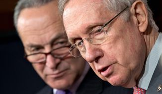 Senate Majority Leader Harry Reid of Nevada (right) and Sen. Charles E. Schumer, New York Democrat, face reporters Thursday on Capitol Hill to talk about the automatic government spending cuts that take effect Friday. (Associated Press)