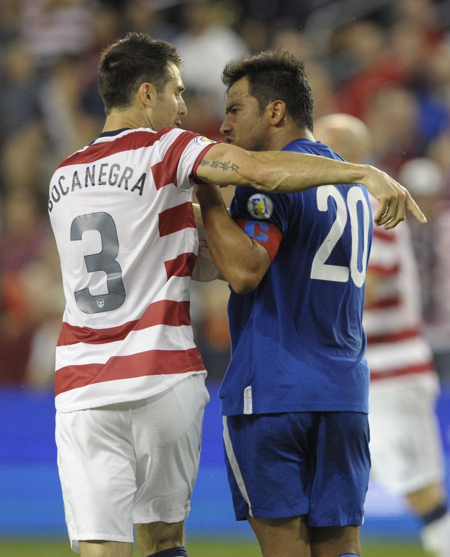 United States defender Carlos Bocanegra (3) and Guatemala forward Carlos Ruiz (20) argue during the first half of a World Cup qualifying soccer match in Kansas City, Kan., Tuesday, Oct. 16, 2012. (AP Photo/Reed Hoffmann)