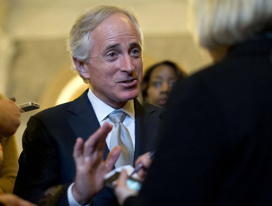 ** FILE ** Sen. Bob Corker, Tennessee Republican, talks with reporters on Capitol Hill on Feb. 26, 2013, after the weekly Republican policy luncheon. (Associated Press)