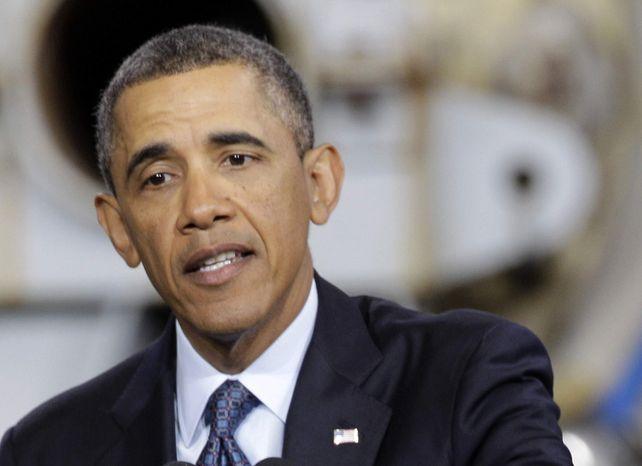 ** FILE ** In this Feb. 26, 2013, file photo, President Barack Obama speaks in Newport News, Va. (AP Photo/Steve Helber, File)