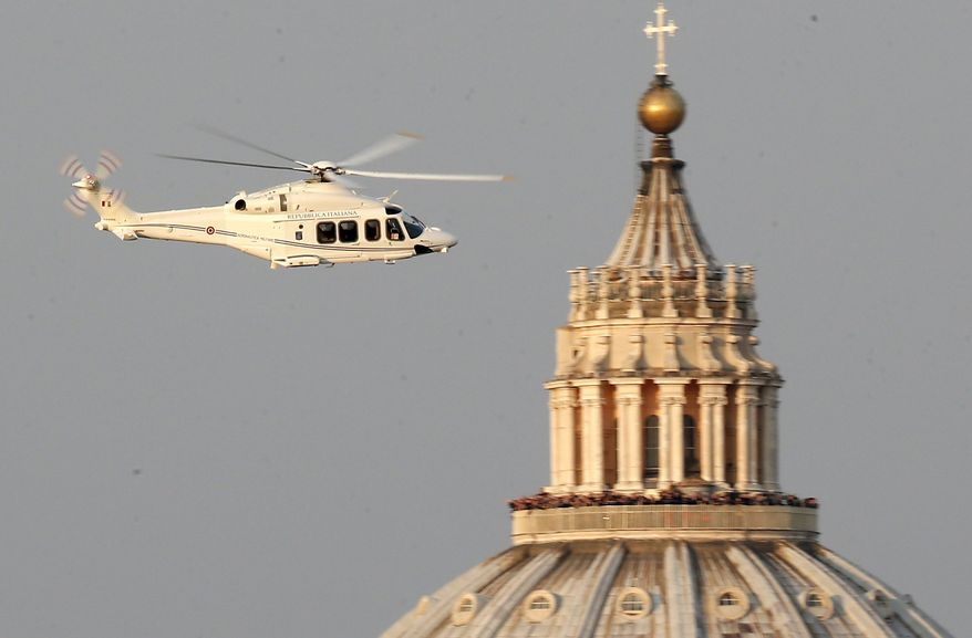 ** FILE ** A helicopter with Pope Benedict XVI onboard leaves the Vatican in Rome, Thursday, Feb. 28, 2013. (AP Photo/Michael Sohn)