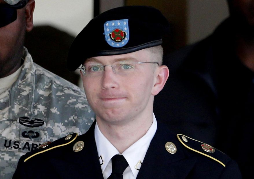 ** FILE ** In this June 25, 2012, file photo, Army Pfc. Bradley Manning, right, is escorted out of a courthouse in Fort Meade, Md. (AP Photo/Patrick Semansky, File)