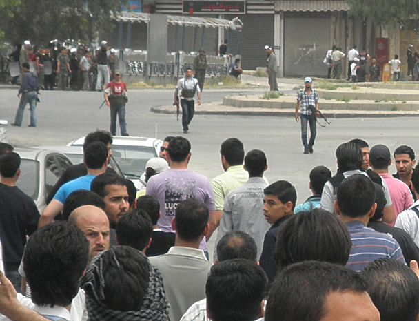**FILE** Syrian security forces hold machine guns and surround anti-Syrian regime mourners in the Kfar Suseh area of Damascus, Syria, on April 30, 2012, during the funeral procession of the activist Nour al-Zahraa, 23, who was shot by the Syrian security forces. (Associated Press)