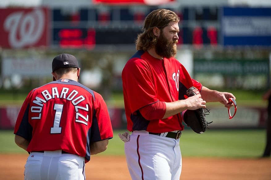 Washington Nationals second baseman Stephen Lombardozzi (1) and Washington Nationals right fielder Jayson Werth (28) takes the field as the Washington Nationals play the Florida Marlins during spring training at Space Coast Stadium, Viera, Fla., Wednesday, February 27, 2013. (Andrew Harnik/The Washington Times)