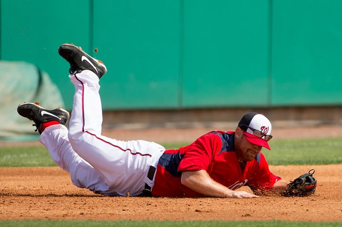 Washington Nationals first baseman Chad Tracy (18) dives for a ball as the Washington Nationals play the Florida Marlins during spring training at Space Coast Stadium, Viera, Fla., Wednesday, February 27, 2013. (Andrew Harnik/The Washington Times)