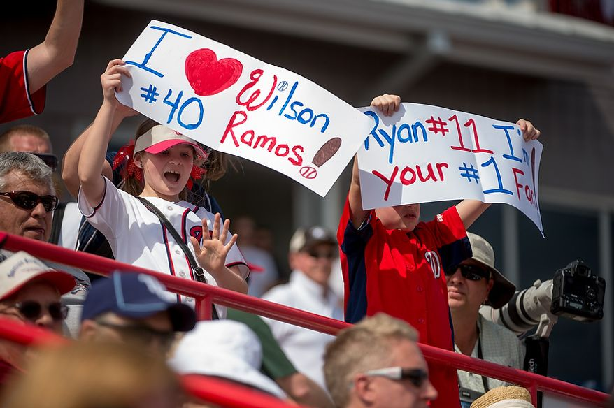 Fans cheer for Washington Nationals catcher Wilson Ramos (40) as the Washington Nationals play the Florida Marlins during spring training at Space Coast Stadium, Viera, Fla., Wednesday, February 27, 2013. (Andrew Harnik/The Washington Times)