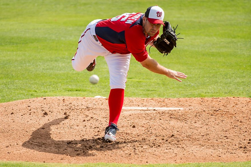 Washington Nationals relief pitcher Craig Stammen (35) pitches as the Washington Nationals play the Florida Marlins during spring training at Space Coast Stadium, Viera, Fla., Wednesday, February 27, 2013. (Andrew Harnik/The Washington Times)