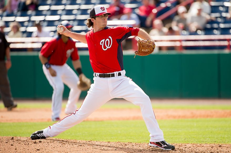 Washington Nationals relief pitcher Erik Davis (55) pitches as the Washington Nationals play the Florida Marlins during spring training at Space Coast Stadium, Viera, Fla., Wednesday, February 27, 2013. (Andrew Harnik/The Washington Times)