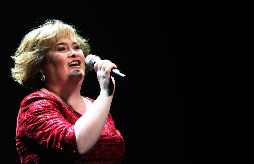 """**FILE** Susan Boyle performs March 27, 2012, during her musical 'I Dreamed A Dream' at the Theatre Royal in Newcastle, England. Boyle is making her big-screen acting debut in a Christmas-themed British period drama. The Scottish singer appears in """"The Christmas Candle,"""" a story of angels and wishes set in an English village in the 1890s. (Associated Press)"""