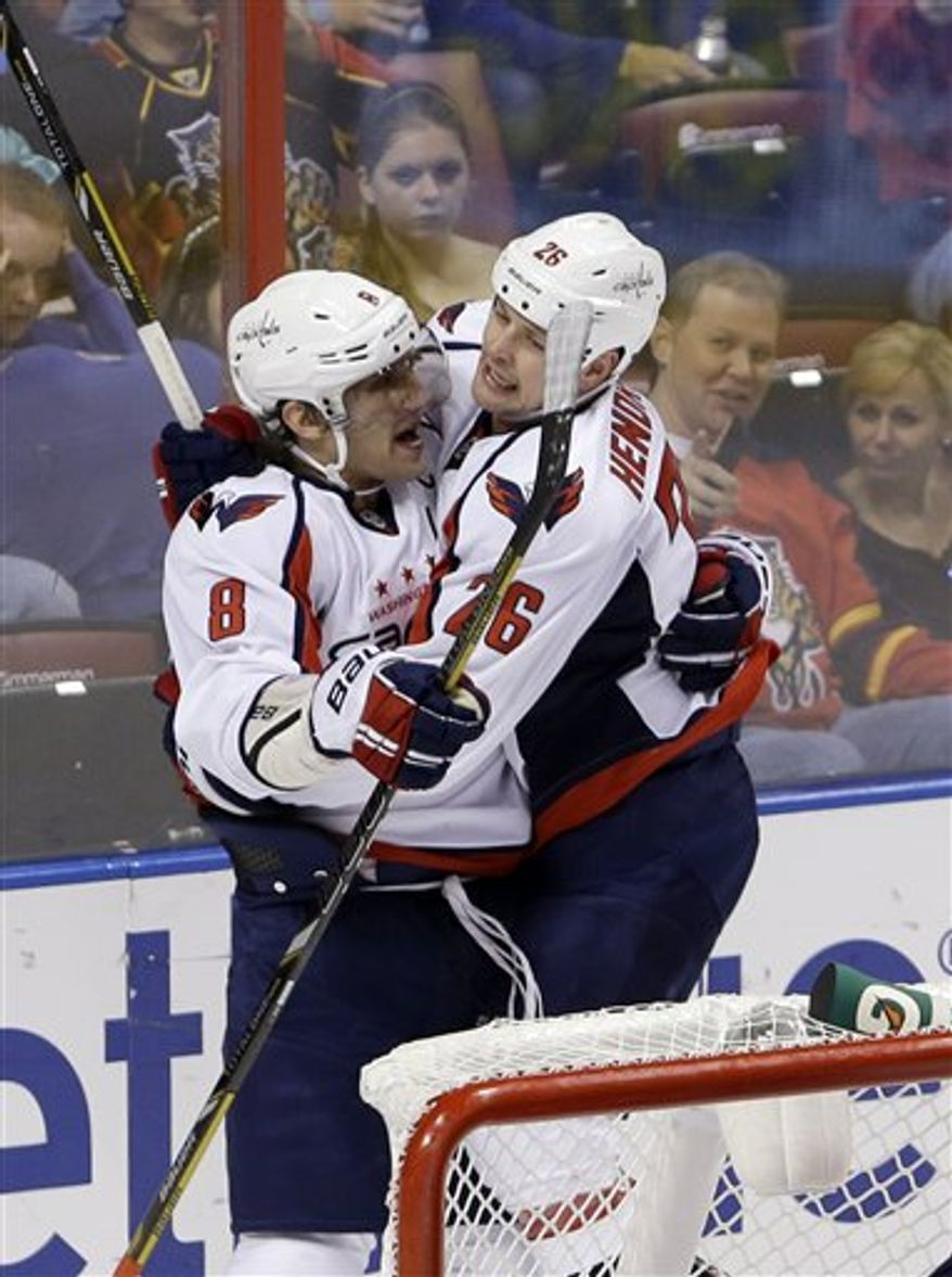 Washington Capitals center Matt Hendricks (26) celebrates with left wing Alex Ovechkin (8) of Russia after Hendricks scored a goal during the second period of an NHL hockey game against the Florida Panthers, Tuesday, Feb. 12, 2013 in Sunrise, Fla. (AP Photo/Wilfredo Lee)
