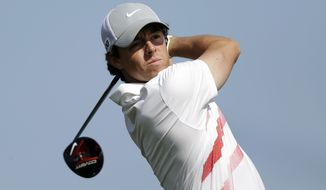 Rory McIlroy, of Northern Ireland, watches his tee shot on the 10th hole during the first round of the Honda Classic golf tournament, Thursday, Feb. 28, 2013, in Palm Beach Gardens, Fla. (AP Photo/Wilfredo Lee)