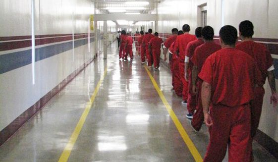 In this undated photo, immigrants walk to hearings at the Stewart Detention Center in Lupmkin, Georgia. (Associated Press/Atlanta Journal-Constitution) **FILE**