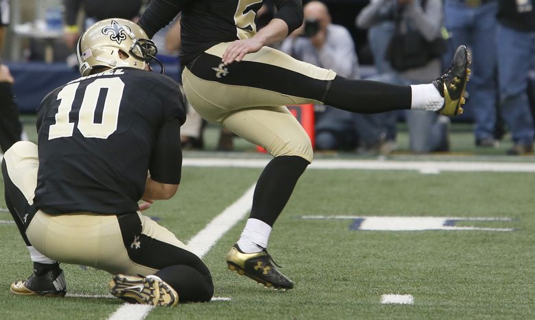 **FILE** New Orleans Saints kicker Garrett Hartley watches his game winning field goal with teammate Chase Daniel during overtime play of the Saints' 34-31 win against the Dallas Cowboys on Dec. 23, 2012, in Arlington, Texas. (Associated Press)