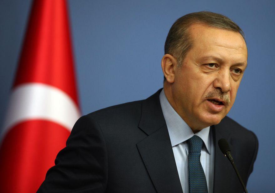 Turkish Prime Minister Recep Tayyip Erdogan speaks during a joint news conference with German Chancellor Angela Merkel, unseen, in Ankara, Turkey, Monday, Feb. 25, 2013. (AP Photo/Burhan Ozbilici)