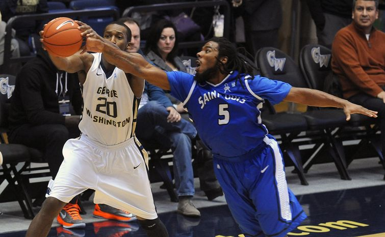 Saint Louis forward Jordair Jett (5) steals the ball away from George Washington forward Lasan Kromah (20) during first half of their NCAA college basketball game, Saturday, March 2, 2013, in Washington. (AP Photo/Richard Lipski)