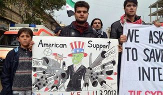 This citizen journalism image provided by Edlib News Network, ENN, which has been authenticated based on its contents and other AP reporting, shows anti-Syrian regime protesters holding a caricature placard during a demonstration, at Kafr Nabil town, in Idlib province, northern Syria, Friday, March. 1, 2013.