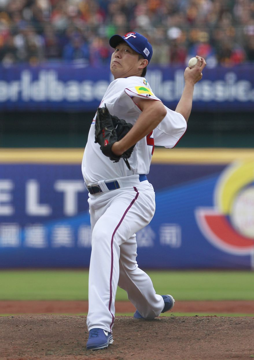 Taiwan's starter Wang Chien-ming delivers a pitch against Australia in the first inning of their World Baseball Classic first round game at the Intercontinental Baseball Stadium in Taichung, Taiwan, Saturday, March 2, 2013. Taiwan won 4-1. (AP Photo/Wally Santana)