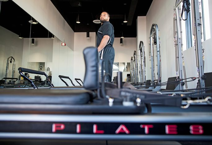 Kedric Golston (pictured at the November 2011 grand opening) and Lorenzo Alexander have expanded The Studio MBS beyond Pilates to include other classes and even after-school care for kids. (Pratik Shah/The Washington Times)