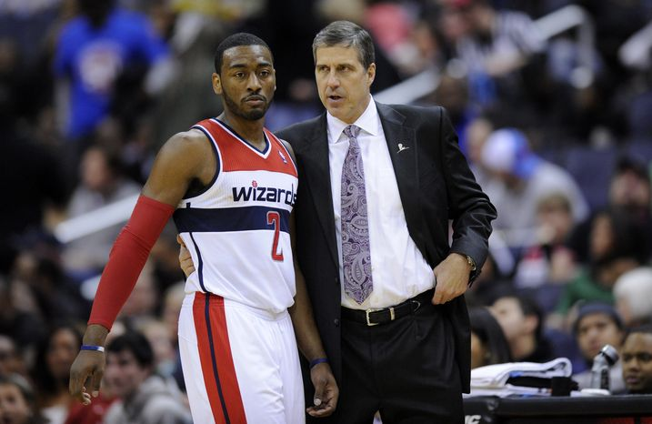 Washington Wizards head coach Randy Wittman, right, speaks with guard John Wall (2) during the second half of an NBA basketball game against the Philadelphia 76ers, Sunday, March 3, 2013, in Washington. The Wizards won 90-87. (AP Photo/Nick Wass)
