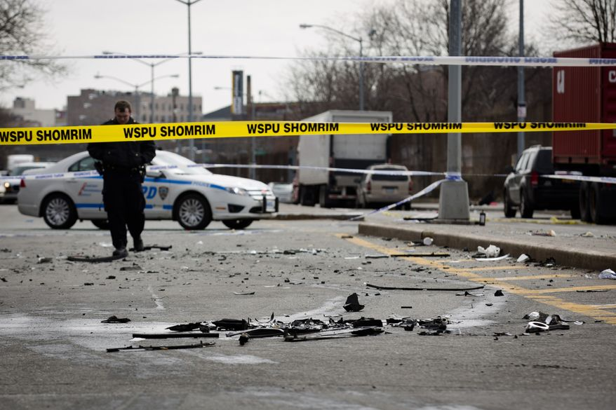 Debris from an auto accident that claimed the lives of two expectant parents litter Kent Avenue on Sunday, March 3, 2013, in the Brooklyn borough of New York. Their baby, who was born prematurely, survived and is in serious condition. (AP Photo/John Minchillo)