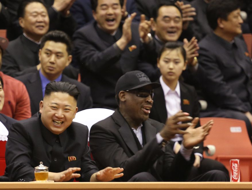 North Korean leader Kim Jong-un (left) and former NBA star Dennis Rodman watch North Korean and U.S. players in an exhibition basketball game at an arena in Pyongyang, North Korea, on Thursday, Feb. 28, 2013. (AP Photo/VICE Media, Jason Mojica) ** FILE **