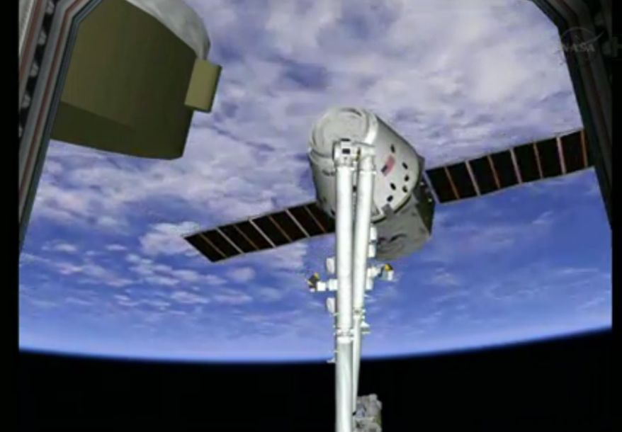 SpaceX Dragon capsule is shown on the end of the International Space Station's robotic arm on Sunday, March 3, 2013. SpaceX, the California-based company founded by billionaire Elon Musk, had to struggle with the Dragon following its launch Friday from Cape Canaveral. The spacecraft is delivering more than 1 ton of supplies to the the space station. (AP Photo/NASA TV)