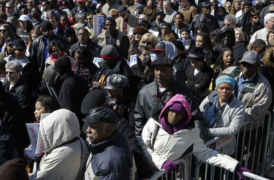 Thousands await the arrival of Vice President Joseph R. Biden in Selma, Ala., on Sunday, March 3, 2013, to participate in the Bridge Crossing Jubilee. The event commemorates the 1965 march from Selma to Montgomery, Ala., that prompted Congress to pass the Voting Rights Act and add millions of blacks to Southern voter rolls. (AP Photo/Dave Martin)