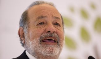 Mexican telecommunications tycoon Carlos Slim speaks during news conference at the Soumaya Museum in Mexico City on Monday, Jan. 14, 2013. Mr. Slim remains the world's richest man for the fourth year in a row, Forbes says, while Warren Buffett dropped out of the top three for the first time since 2000. (AP Photo/Dario Lopez-Mills)
