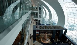 Passengers walk in the new Concourse A of Dubai International Airport in Dubai, United Arab Emirates, on Sunday, Feb. 10, 2013. (AP Photo/Kamran Jebreili)