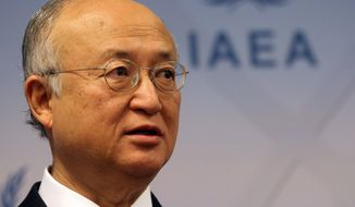 The Director General of the International Atomic Energy Agency, IAEA, Yukiya Amano of Japan addresses the media during a news conference after a meeting of the IAEA board of governors at the International Center in Vienna Austria, Monday, March 4, 2013. (AP Photo/Ronald Zak)