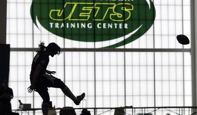Lauren Silberman boots the ball during kicker tryouts at an NFL football regional combine workout, Sunday, March 3, 2013, at the New York Jets' training facility in Florham Park, N.J. (AP Photo/Mel Evans)