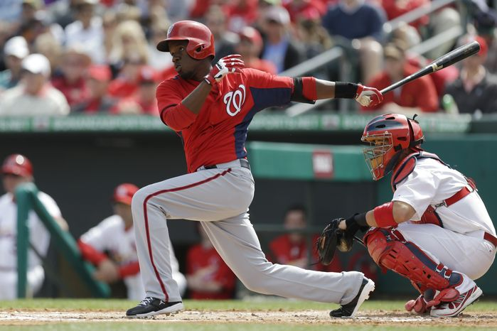 Washington Nationals outfielder Eury Perez swings at a pitch from St. Louis Cardinals starting pitcher Adam Wainwright during the second inning of an exhibition spring training baseball game, Saturday, March 2, 2013, in Jupiter, Fla. (AP Photo/Julio Cortez)