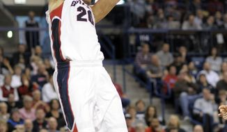 Gonzaga's Elias Harris (20) dunks against Portland in the second half of an NCAA college basketball game on Saturday, March 2, 2013, in Spokane, Wash. Gonzaga defeated Portland 81-52. Harris led Gonzaga with 20 points. (AP Photo/Jed Conklin)