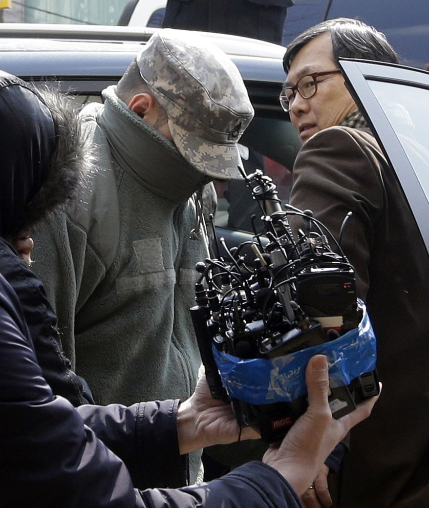 An unidentified U.S. soldier arrives for questioning at a police station in Seoul on March 4, 2013. South Korean police said they are questioning U.S. soldiers over a high-speed car chase that resulted in a Seoul officer shooting a soldier after being hit by a car. (Associated Press)