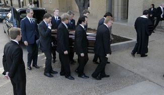 Pallbearers carry the casket of classical pianist Van Cliburn into the Broadway Baptist Church in Fort Worth, Texas, for his funeral service on Sunday, March 3, 2013. (AP Photo/Star-Telegram, Ron T. Ennis, Pool)