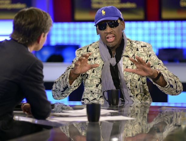 """In this photo made available by ABC Television on March 4, 2013, """"This Week"""" host George Stephanopoulos (left) interviews former NBA star Dennis Rodman in New York on March 3, 2013, about his visit with North Korean leader Kim Jong Un. (Associated Press/ABC Television)"""