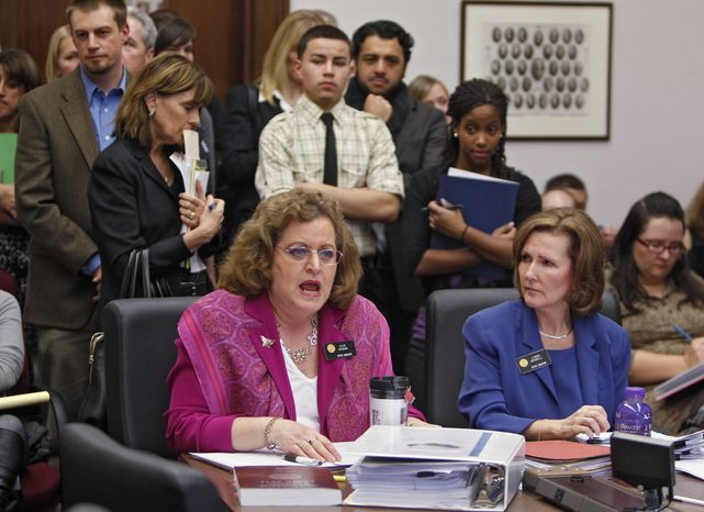 **FILE** Colorado state Sens. Evie Hudak (left), Westminster Democrat, and Linda Newell, Littleton Democrat, testify on their joint bill on school discipline during a hearing at the Capitol in Denver on Feb. 16, 2012. (Associated Press)