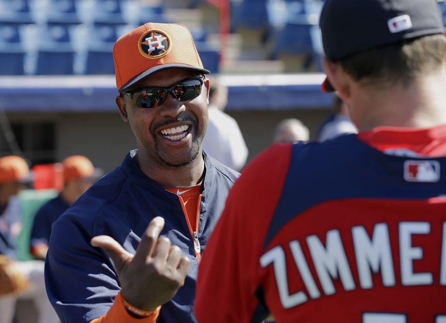 Houston Astros manager Bo Porter, left, talks with Washington Nationals third baseman Ryan Zimmerman, right, before an exhibition spring training baseball game Tuesday, March 5, 2013, in Viera, Fla. (AP Photo/David J. Phillip)