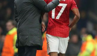 Real Madrid's coach Jose Mourinho from Portugal pats Manchester United's Nani on the back as he leaves the field after being shown a red card during the Champions League round of 16 soccer match at Old Trafford Stadium, Manchester, England, Tuesday, March 5, 2013. (AP Photo/Jon Super)