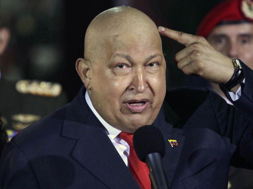 ** FILE **Venezuela's deceased president Hugo Chavez (AP Photo/Ariana Cubillos, file)