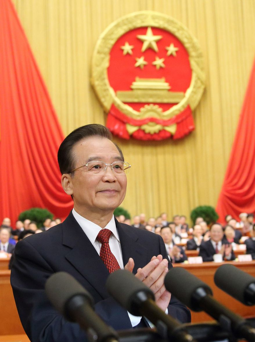 In this photo provided by China's Xinhua News Agency, Chinese Premier Wen Jiabao delivers the government work report during the opening meeting of the first session of the National People's Congress at the Great Hall of the People in Beijing, Tuesday, March 5, 2013. (AP Photo/Xinhua, Lan Hongguang)