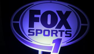 A logo for the new Fox Sports 1 channel is displayed during a news conference in New York, Tuesday, March 5, 2013. Fox says its new sports cable network will launch Aug. 17. (AP Photo/Seth Wenig)